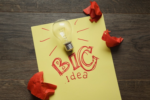 Big idea with lightbulb and red crumpled papers
