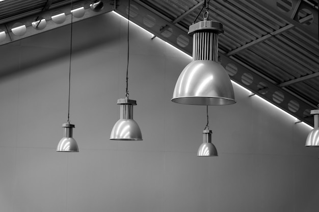 Big lamp silver on ceiling factory, black and white tone