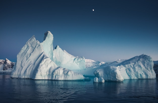 Big massive iceberg floating on the ocean