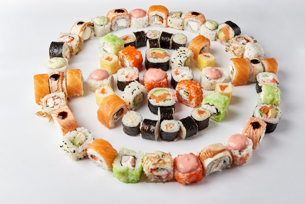 Big mix of sushi  rolls, macro. japanese traditional food. dishes from raw fish