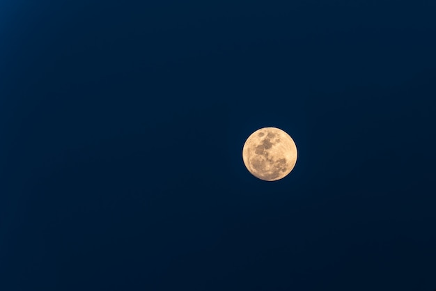 Big moon on blue sky background