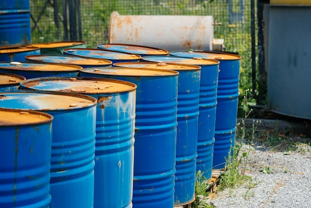 Big oil drums, blue. chemical barrels in an open warehouse. rusty barrels. barrel for oil.