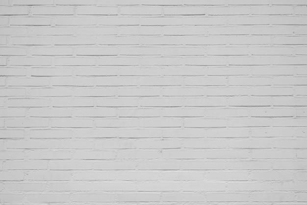 Grande vecchia parete di mattoni bianca per fondo