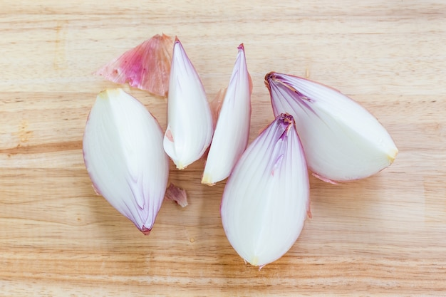 Big onion and slices on wooden cutting board