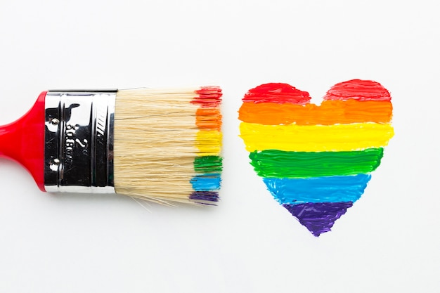 Big paint brush and rainbow heart close-up