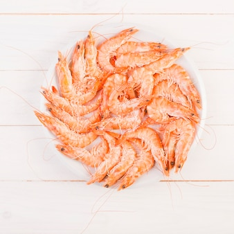 Big plate with shrimps on table