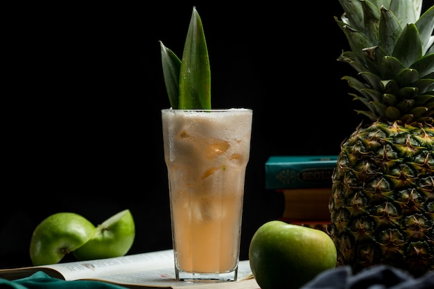 A big portion of pinapple apple mixed summer drink