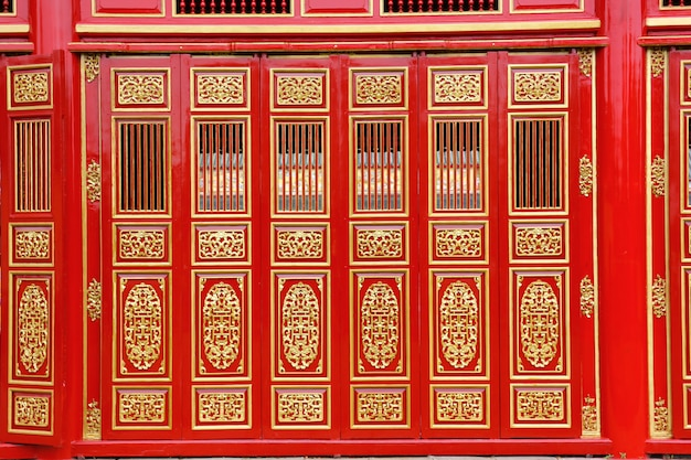 The big red carving wood doors in the hue palace