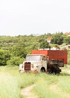 Big rusty truck on field