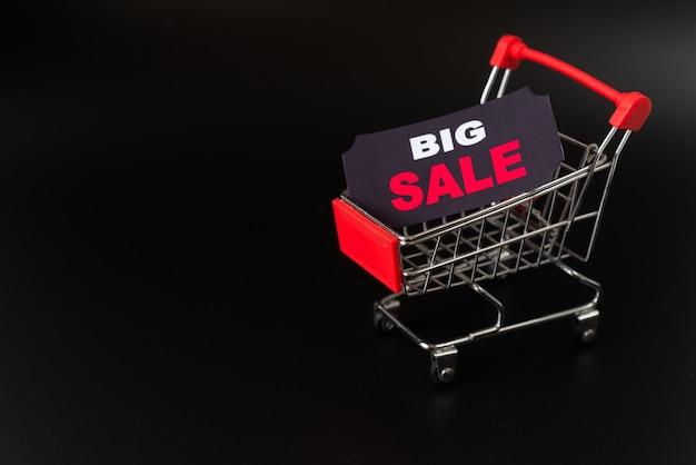 Big sale sticker in shopping cart