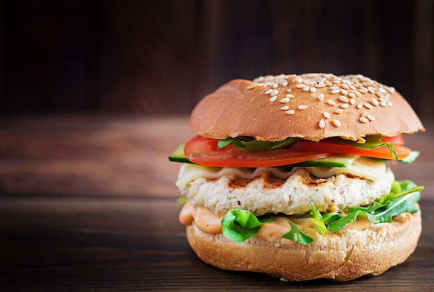 Big sandwich - hamburger burger with turkey meat,  tomato,  cucumber and lettuce