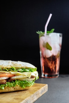 Big sandwich with pink drink cocktail