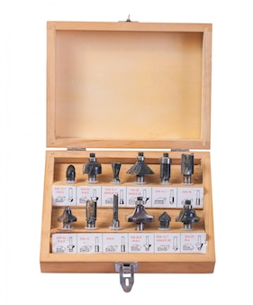 Big set of roundover router bits for woodworking in wooden box isolated