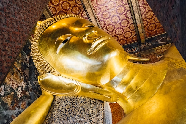 Big sleep gold buddha statue at temple in bangkok,thailand