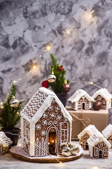 Big and small ginger houses - a village of ginger houses on a gray background with lights