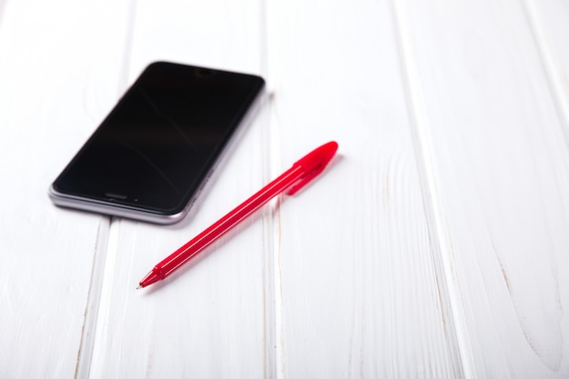 Big smartphone and pen business concept