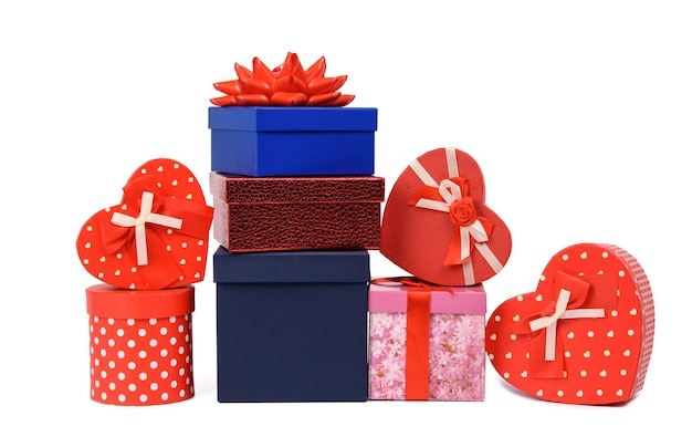 Big stack of gifts wrapped in brown kraft paper and tied with silk ribbon, boxes isolated on white background, element for designer