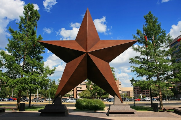 Big star decorated in the city against blue sky.