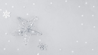 Big star with snowflake on table