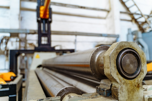 Big steel construction of tubes for cutting metal in workshop.