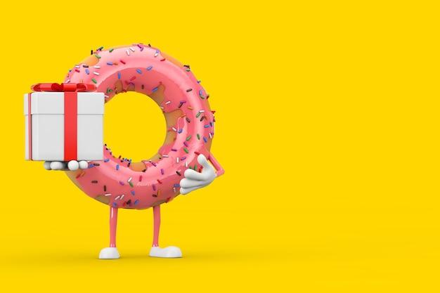 노란색 배경에 빨간 리본이 달린 선물 상자가 있는 큰 딸기 핑크 글레이즈드 도넛 캐릭터 마스코트. 3d 렌더링