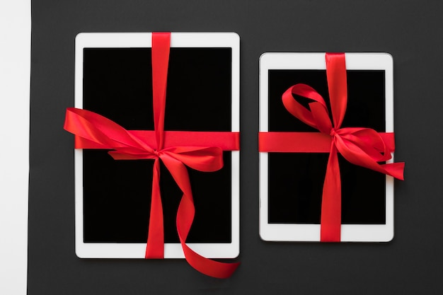 Big tablets with red ribbons