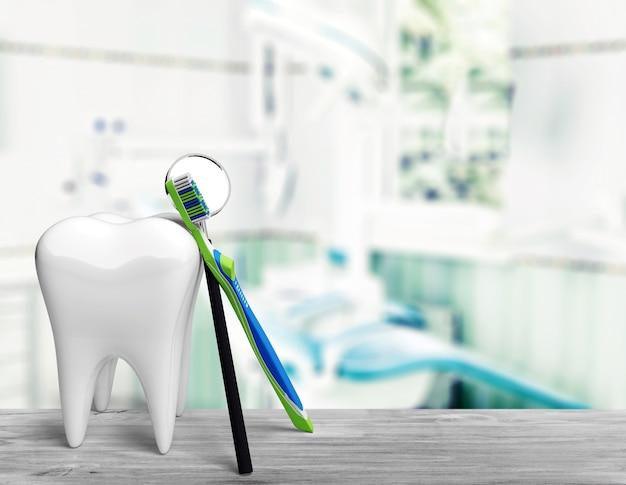 大きな歯のモデルと明るい背景の歯ブラシ