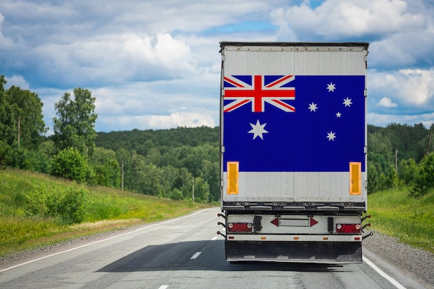 Big  truck with the national flag of  australia moving on the highway