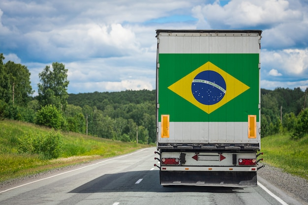 Big  truck with the national flag of  brazil moving on the highway