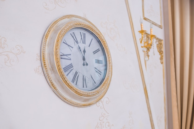 Big wall clock. antique interior. vintage clock on the wall.