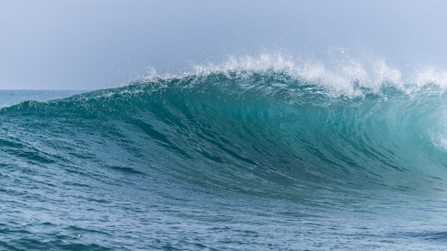 Big wave of a sea against the blue sky
