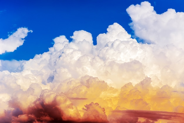 Big white clouds in blue sky background