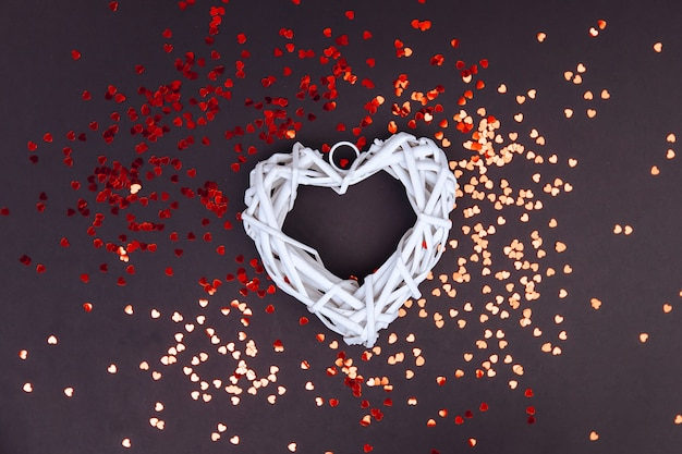 Big white heart on the edges of many small hearts. space for copying. valentine's day