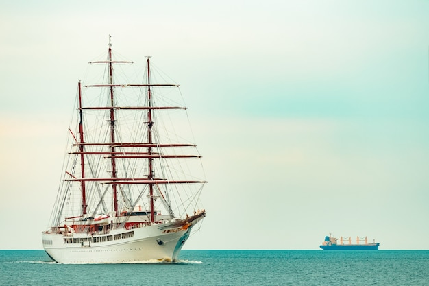 Big white sailing ship with three mast moving to the riga port