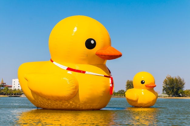 Big yellow duck on the water on blue sky