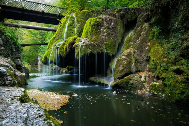 Bigar waterfall is situated on 45 parallel, in the forest of anina mountains, caras severin county, romania