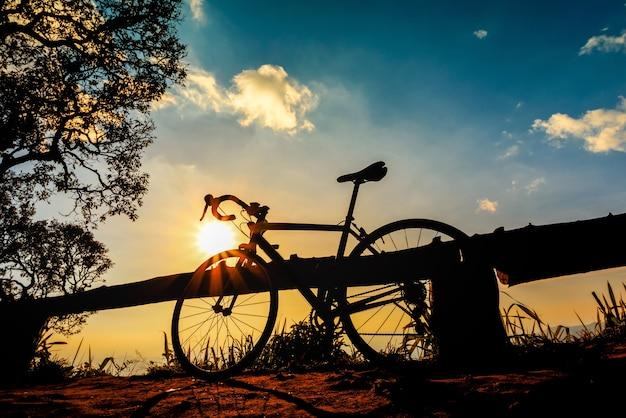 Bike silhouette on sunset sky background