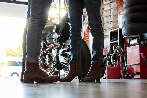 Biker couples during the preparation of travel trips