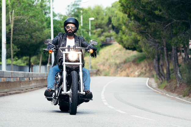 Biker driving his motorcycle on the road