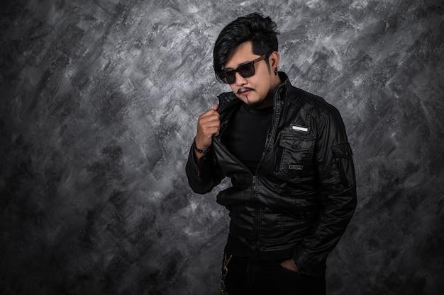 Biker man in black leather jacket