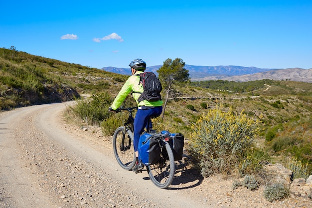 Biker mtb cycle tourism with panniers in spain