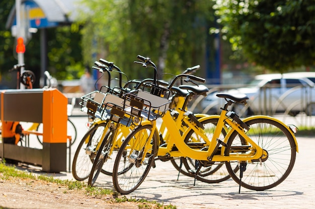 Bikes to rent in the parking lot in the city