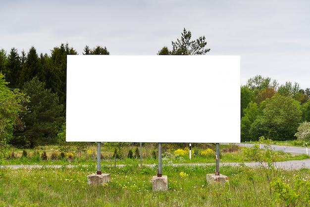 Billboard on a background of green nature