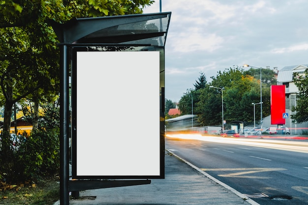 Billboard at bus stop shelter with blurred trail light