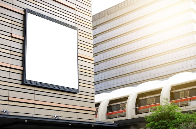 Billboard outside the building near the skytrain mockup of banner placeholder