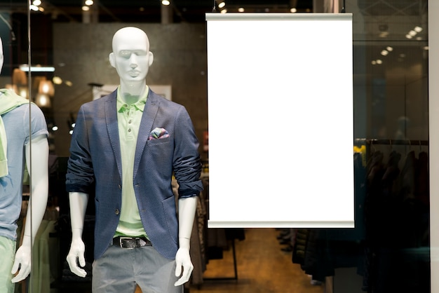 Billboard on window display next to manikin