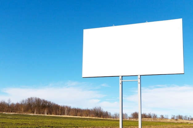 Billboard with white copy space on road side