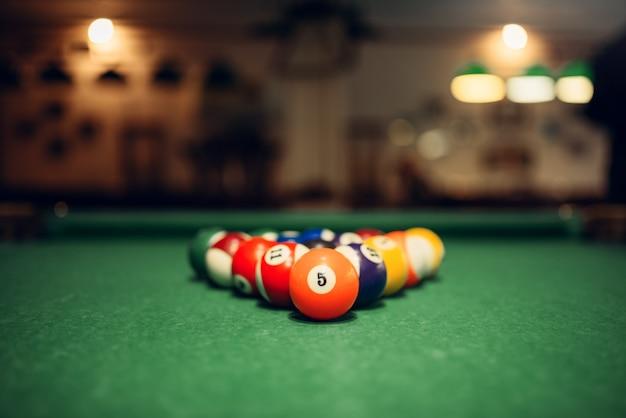 Billiard balls on green table, closeup, nobody, american pool game
