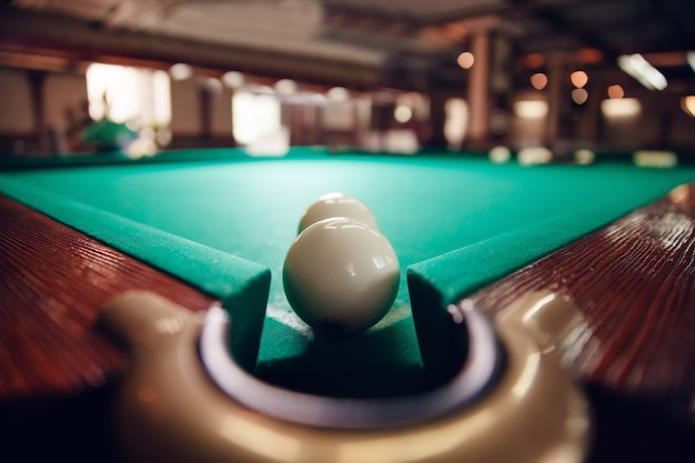 Billiard balls near pocket