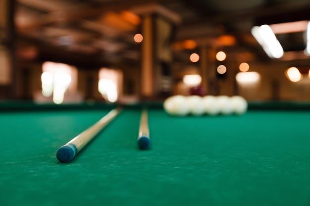 Billiard balls and pool sticks